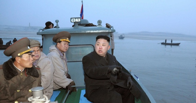 In this March 7, 2013 photo released by the Korean Central News Agency (KCNA) and distributed March 8, 2013 by the Korea News Service, North Korean leader Kim Jong Un, with military officials, gets a ride on a boat on his way to a military unit on Jangjae